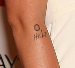 Pink's Help Button Tattoo