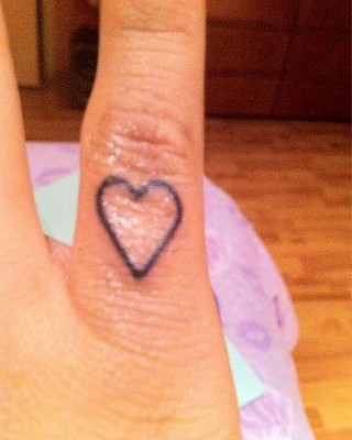 Miley Cyrus Heart Finger Tattoo