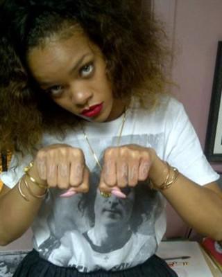 Rihanna's Infamous Thug Life Knuckles Tattoo