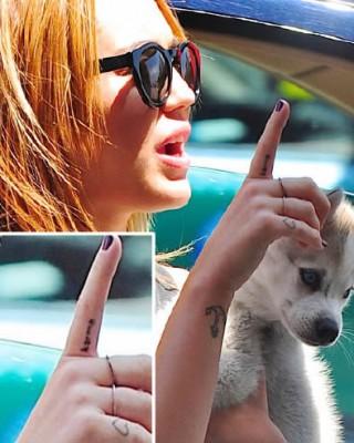 Miley Cyrus' Karma Tattoo
