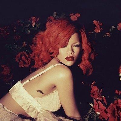 Rihanna's Little Side Gun Tattoo
