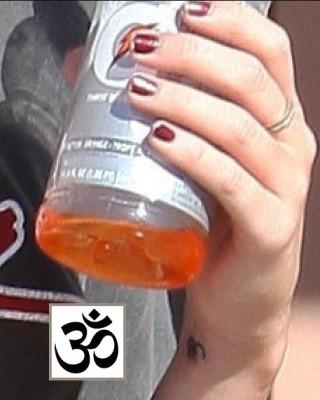 Miley Cyrus' Om Tattoo