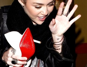miley cyrus wrist om tattoo