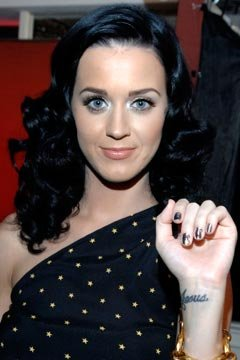 Katy Perry Wrist Jesus Tattoo