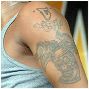 Chris Brown Left Arm Tattoos