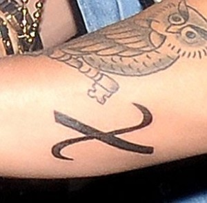 justin bieber greek christ tattoo