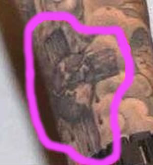 Justin Bieber cross tattoo close-up