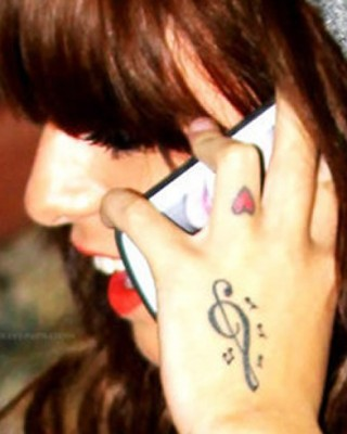Cher Lloyd's Tiny Heart Tattoo on Her Finger