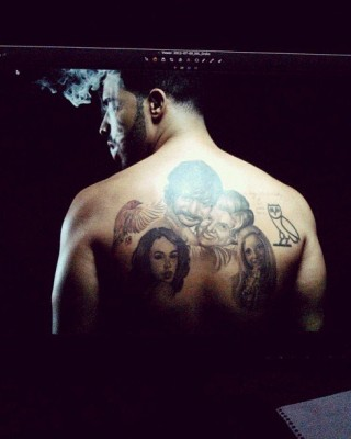 Who's That on Your Back?? Drake Finally Reveals Mysterious Portrait Back Tattoo