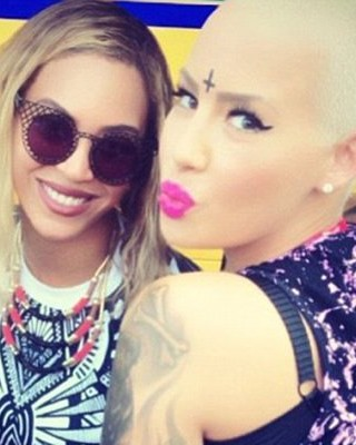 What is Amber Rose Thinking with Her New Inverted Cross Forehead Tat?