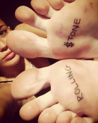 "Miley Cyrus' ""Rolling $tone"" Tattoos on Her Feet"