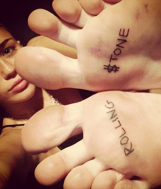 """Miley Cyrus' """"Rolling $tone"""" Tattoos on Her Feet"""