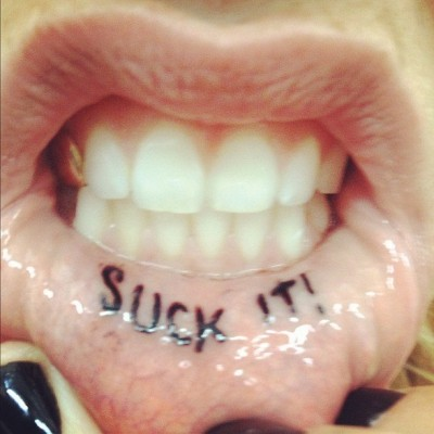 kesha suck it tattoo