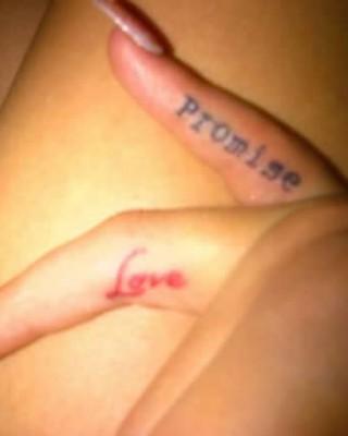 "Rita Ora's Red ""Love"" Tat on Her Ring Finger"