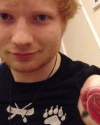 Ed Sheeran Celebrates the Holidays With New Red Rose Tattoo on His Arm
