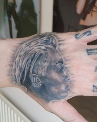 Miley Cyrus Fanatic Carl McCoid Debuts New Portrait Tat on His Hand, Making 23 Miley Tats