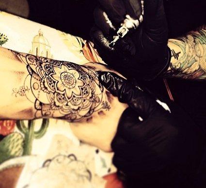 Malik gets new henna style flower wrist tattoo at l a tattoo parlor