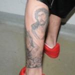 justin-bieber-jail-photos-leg-tattoos