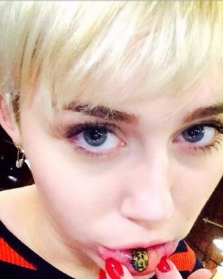 "Miley Cyrus Gets Bizarre ""Sad Kitty"" Tattoo Inside Her Lip"
