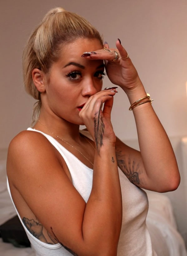 Rita Ora's Delicate Feather Tattoo on Her Hand
