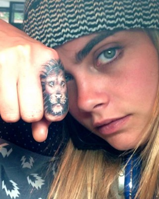 "Cara Delevingne's ""Breathe Deep"" Tat Keeps Her from Punching Paparazzi"