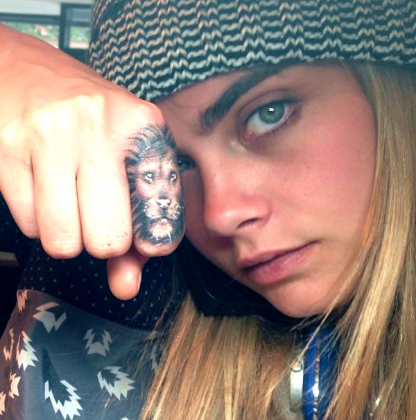 """Cara Delevingne's """"Breathe Deep"""" Tat Keeps Her from Punching Paparazzi"""