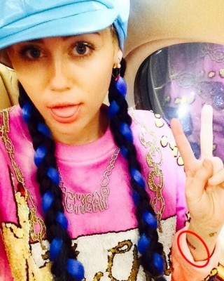 """Miley Cyrus Marks Melbourne Arrival With New Wrist """"Wukong"""" Tattoo Dedicated to Brother Braison"""