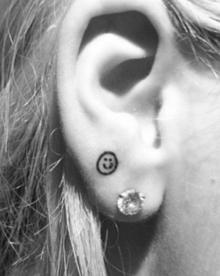 Rita Ora Shows Off New Smiley Face Earlobe Tattoo Following The Voice UK Debut