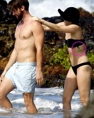 Miley Cyrus Flaunts New Naked Woman Side Tattoo During Hawaii Vacay