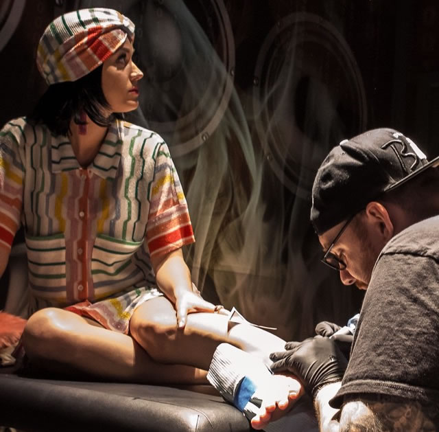 Katy perry gets rainbow triangle tattoo to mark prismatic for Tattoo shops in katy