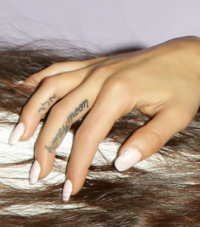 Ariana Grande Shows Off TWO New Finger Tattoos on Tour!