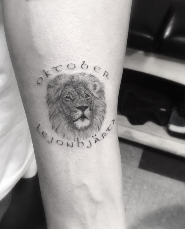 "Drake Honors Brand, Favorite Month with ""Oktober"" Lion Tattoo"
