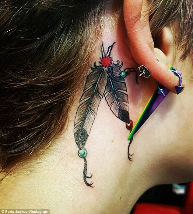 Paris Jackson's Latest Tattoo a Double Feather Inked Behind Her Ear