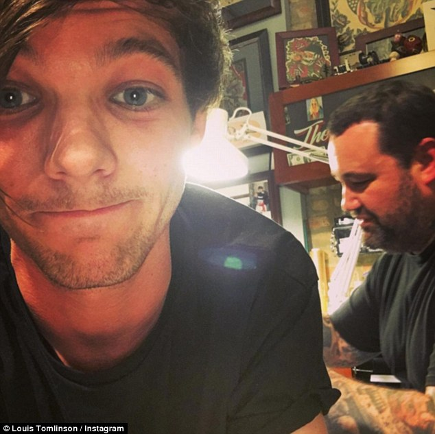 Louis Tomlinson Confirms the Tattoo on His Butt is of a Penguin Wearing Headphones